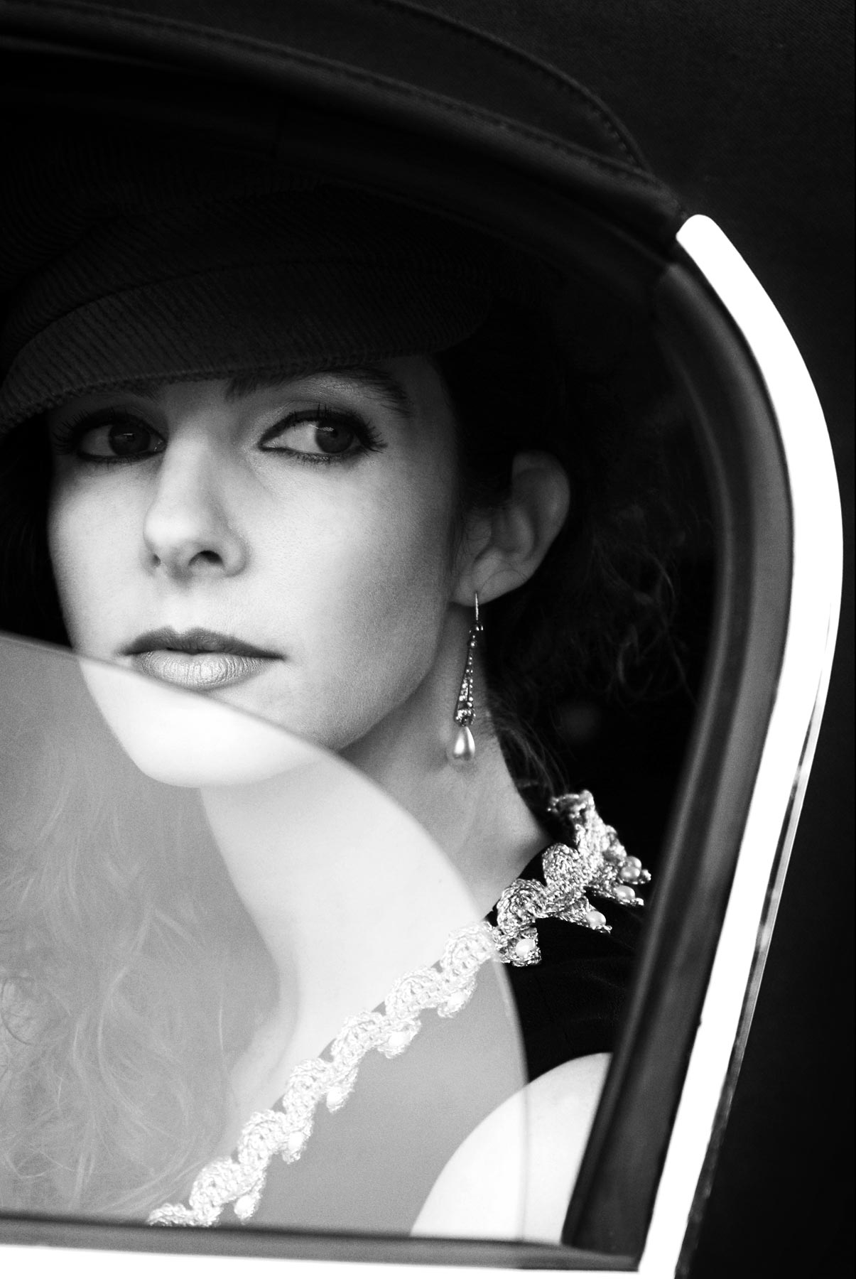 A girl in an Etype Jaguar mk1