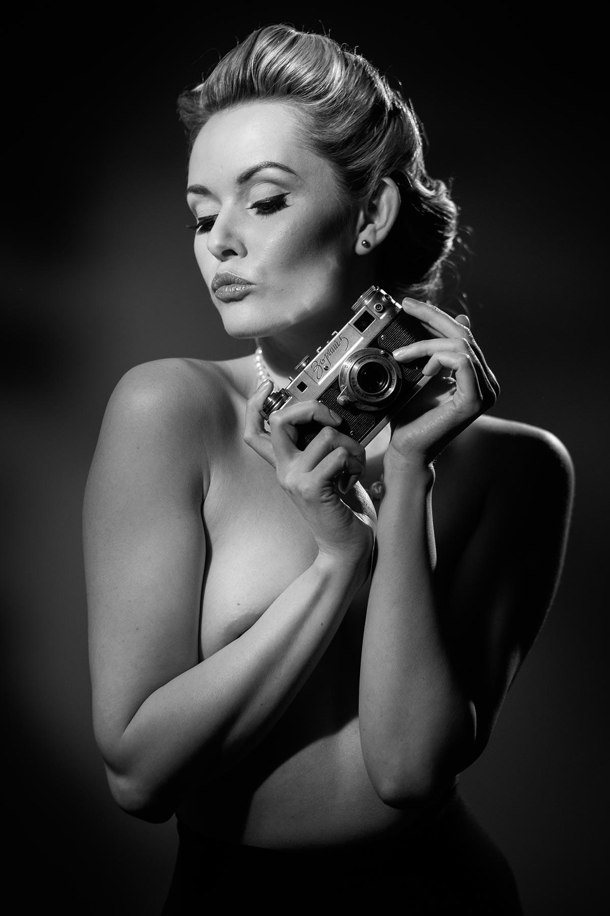 Carla Monaco holding a Zorki 5 Camera in monochrome